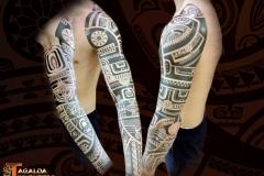 Tatouage bras complet Marquisien tiki tattoo